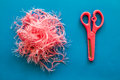 Pink toy scissors and fabric on blue background paper Royalty Free Stock Photo