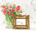 Pink tulip flowers golden picture frame Royalty Free Stock Photo