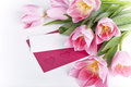 pink tulips with a blank card for greetings Royalty Free Stock Photo