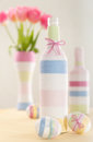 Pink tulips easter eggs handmade yarn wrapped bottle Stock Photography