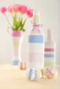 Pink tulips, Easter eggs and yarn wrapped bottle Royalty Free Stock Image