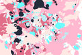 Pink turquoise black ink splashes background