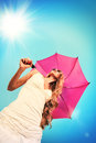 Pink umbrella beautiful young woman in sunglasses holding over sky Stock Photography