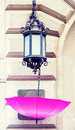 Pink umbrella open hunging on the street lamp Stock Images