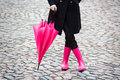 Pink umbrella and pink rubber boots woman with holding Royalty Free Stock Image