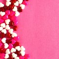 Pink Valentines Day background with candy heart border Royalty Free Stock Photo