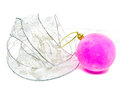 Pink velvety New Year's ball and elegant tinsel on a white background Royalty Free Stock Photo