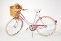 Pink vintage bicycle whith flower basket isolated on white backg Royalty Free Stock Photo