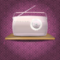 Pink vintage radio on wooden shelf Royalty Free Stock Photo
