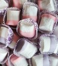 Pink and violet marshmallows at restaurant candy bar