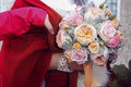 Pink wedding bouquet with orange bow bride holds her Stock Photos