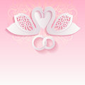 Pink wedding card with swans and intertwined wedding rings. Royalty Free Stock Photo