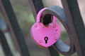 Pink wedding hinged lock lovers hanging on the fence of the brid bridge as a symbol eternal love Royalty Free Stock Photo