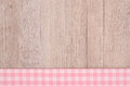 Pink and white checkered cloth on wood as background Stock Photo