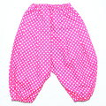Pink with white dots pattern baby pants funny in Stock Image