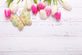 Pink and white tulips flowers and decorative butterfly on vint