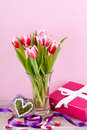 Pink and white tulips present ribbon easter birthday Royalty Free Stock Photo