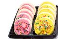 Pink and yellow cookies Stock Images