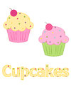Pink and yellow frosted cupcakes sweet with frosting sprinkles with a cherry on top to be used for web design stationery Royalty Free Stock Photography