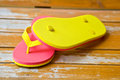 Pink and yellow slipper on wood Stock Image