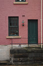 Pinky cherry colour brick townhouse in London Royalty Free Stock Photo