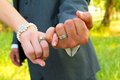 Pinky swear wedding rings bride and groom with their hands together and their fingers interlocked for this unique color image of Stock Image