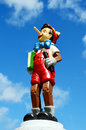 Pinocchio figure standing on a plympth holding a book this figure is part of a huge private collection of life size disney display Royalty Free Stock Photo