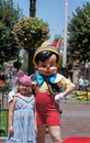 Pinocchio posing with a little girl on main street at disneyland in california Stock Photos
