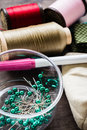 Pins and thread in plastic box with other sewing equipments Stock Images