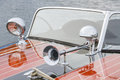 Pinstriped wooden boat with chrome hardware throughout craft Stock Images