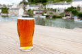 Pint of Real Ale outside a Riverside Village Pub Royalty Free Stock Photo