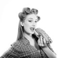 Pinup beautiful blond young woman in curlers Royalty Free Stock Photo