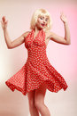 Pinup girl blond wig retro dress dancing. Party. Royalty Free Stock Photo