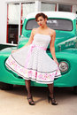 Pinup Girl in Front of Retro Truck Royalty Free Stock Photography