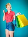 Pinup girl with shopping bags mobile phone Imagenes de archivo