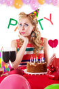 Pinup girl sitting at party table with baloons Royalty Free Stock Photos