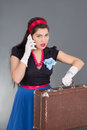 Pinup woman retro suitcase cellphone Royalty Free Stock Photography