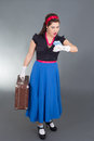 Pinup woman retro suitcase looks clock Stock Photography