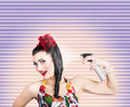 Pinup woman styling a hold with hair product funny portrait of young spraying rolled brunette hairstyle spray in depiction of Royalty Free Stock Images