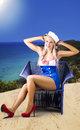 Pinup woman on a tropical beach travel tour Royalty Free Stock Photos