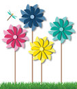 Pinwheels or spinners in summer grass toy the with a dragonfly Royalty Free Stock Images
