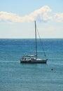 Piombino blue coast and boat in Livorno, Tuscany, Italy Royalty Free Stock Photo