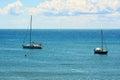 Piombino blue coast and two boat in Livorno, Tuscany, Italy Royalty Free Stock Photo