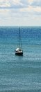 Piombino coast and boat in Livorno, Tuscany, Italy Royalty Free Stock Photo