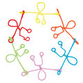 Pipe cleaner figures holding hands in circle Stock Image