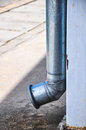 Pipe conduit rain water from the roof Royalty Free Stock Photo