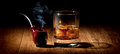 Pipe and scotch tobacco glass of on wooden table Stock Photography