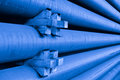 Pipe secure pile of blue colored steel tubes industrial product stored in a way Royalty Free Stock Image