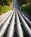 Pipeline at a valley photo Stock Photos