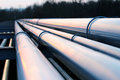 Pipes in crude oil factory during dusk Stock Photography